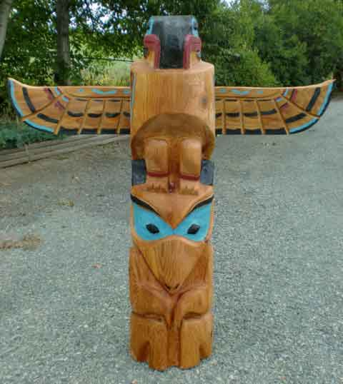 Thunderbird and Wolf Totem Pole Carving